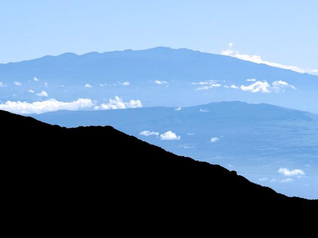 Mauna Kea in distance (with telescopes) from Haleakala on Maui.