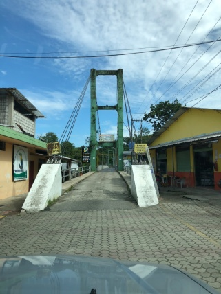 The main river bridge in this Amazonian town (Misahualli) is one lane - and long enough you can hardly see any cars on the other side!