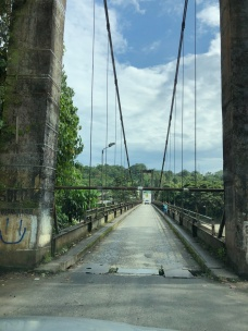 Crossing the Rio Napo at Puerto Misahualli. Tall vehicles (i.e. buses and trucks) not allowed!