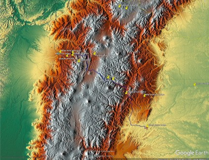 Shaded relief of area shown in previous image. Silver areas are high, green areas are low. Major volcanoes are evident as the conical landforms in various states of erosion.